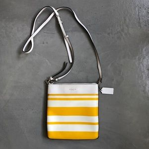 Yellow and white Coach crossbody purse